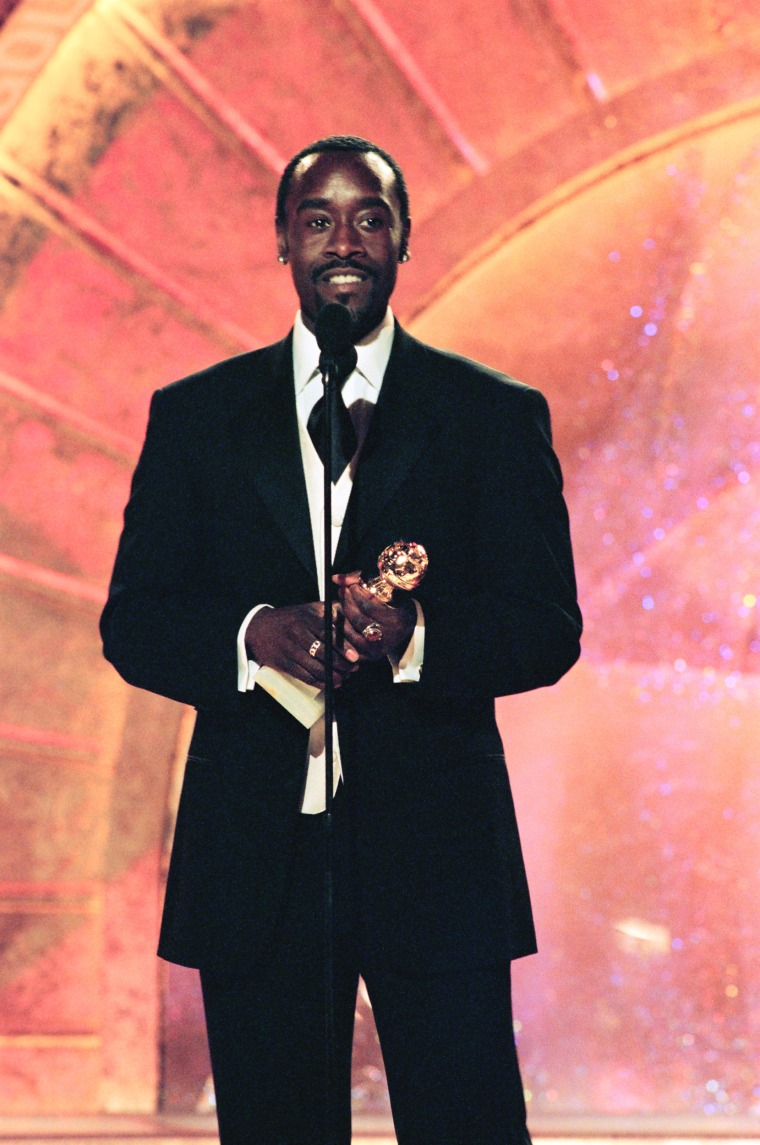 "56TH ANNUAL GOLDEN GLOBE AWARDS -- Pictured: Don Cheadle, Best Actor In A Supporting Role - Series, Mini-Series Or Television Movie for ""The Rat Pack"" on stage during the 56th Annual Golden Globe Awards held at the Beverly Hilton Hotel on January 24, 1999  (Photo by NBC/NBCU Photo Bank via Getty Images)"