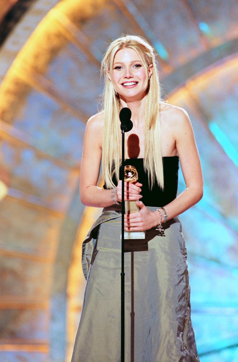 56TH ANNUAL GOLDEN GLOBE AWARDS -- Pictured: Gwyneth Paltrow, Best Actress In A Leading Role - Musical Or Comedy on stage during the 56th Annual Golden Globe Awards held at the Beverly Hilton Hotel on January 24, 1999  (Photo by NBC/NBCU Photo Bank via Getty Images)