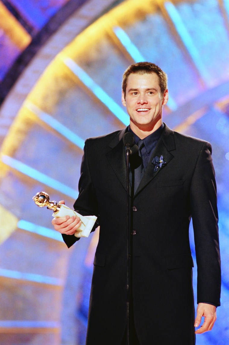 """56TH ANNUAL GOLDEN GLOBE AWARDS -- Pictured: Jim Carrey, Best Actor In A Leading Role - Drama, for \""""The Truman Show\"""" on stage during the 56th Annual Golden Globe Awards held at the Beverly Hilton Hotel on January 24, 1999  (Photo by NBC/NBCU Photo Bank via Getty Images)"""