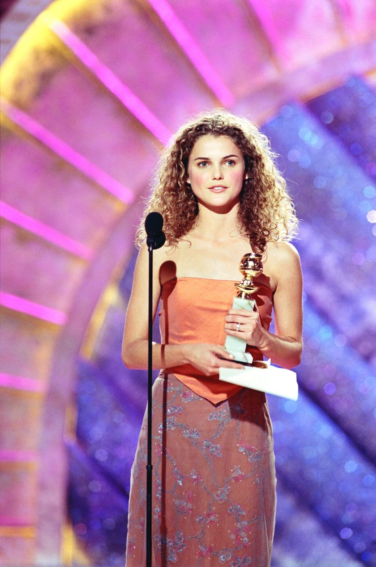 "56TH ANNUAL GOLDEN GLOBE AWARDS -- Pictured: Keri Russell, Best Actress In A Leading Role - Drama Series, for ""Felicity"" on stage during the 56th Annual Golden Globe Awards held at the Beverly Hilton Hotel on January 24, 1999  (Photo by NBC/NBCU Photo Bank via Getty Images)"