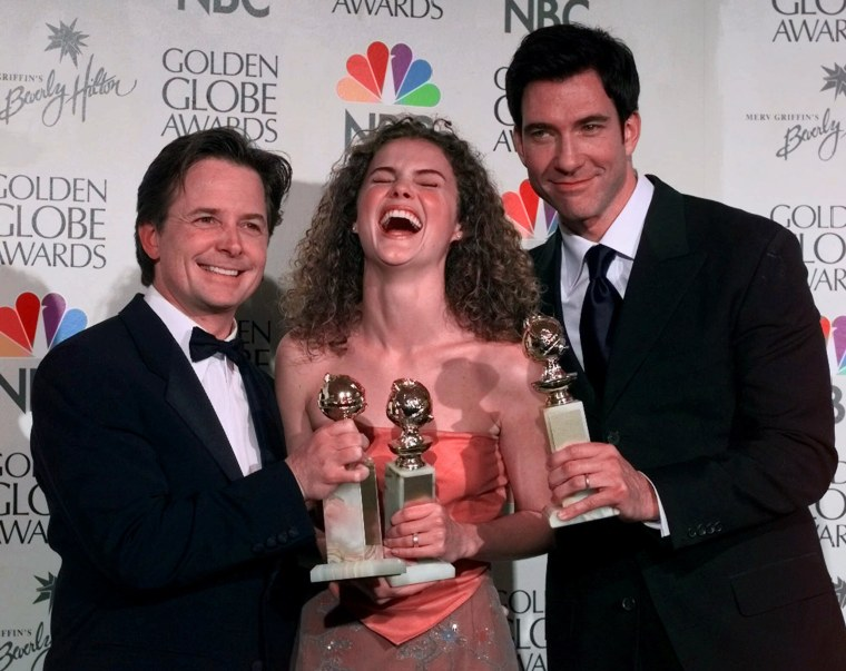 "From left, Michael J. Fox, winner for Best Actor in a Television Comedy Series for ""Spin City,"" Keri Russell, with her award for Best Actress in a Television Drama Series for ""Felicity,"" and Dylan McDermott, Best Actor in a Television Drama Series for ""The Practice"" during the 56th annual Golden Globes in Beverly Hills, Calif., Sunday, Jan. 24, 1999.  (AP Photo/Mark J. Terrill)"
