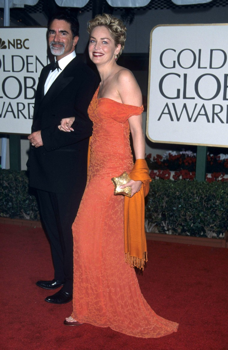 Phil Bronstein and Sharon Stone during The 56th Annual Golden Globe Awards - Red Carpet at Beverly Hilton Hotel in Beverly Hills, California, United States. (Photo by Ke.Mazur/WireImage)