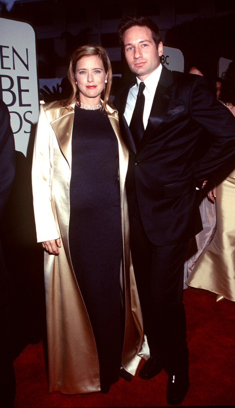 1/24/99 Los Angeles, CA David Duchovny and wife Tea Leoni at the 1999 Golden Globe Awards.