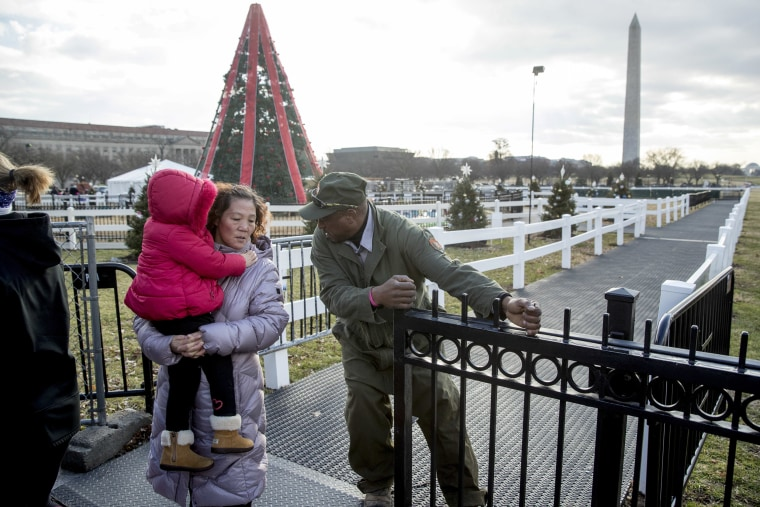 Image: A National Park Service employee closes the gate at the National Christmas Tree in Washington on Dec. 24, 2018.