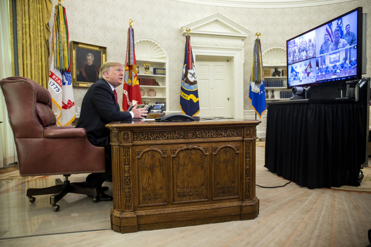 Image: President Donald Trump greets members of the military on video conference on Christmas Day in the Oval Office on Dec. 25, 2018.
