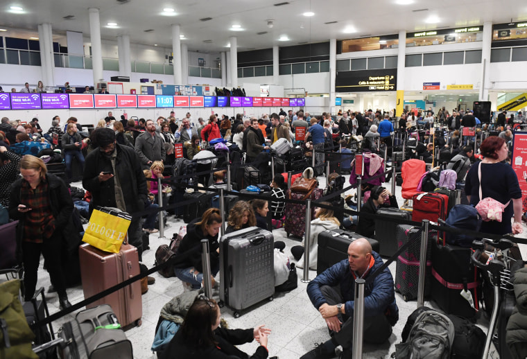 Image:Travelers wait in Gatwick Airport after it was shut down by authorities after sightings of drones in England on Dec. 20, 2018.
