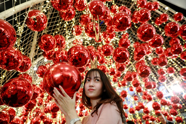 Image: A woman poses with ornaments as she celebrates Christmas in Bangkok, Thailand, on Dec. 25, 2018.