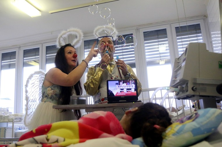 Image: Doctors dressed as clowns visit an intensive care ward at a hospital near Budapest, Hungary, on Dec. 24.