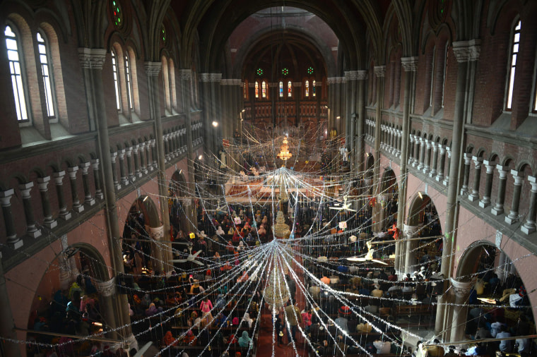 Image: Pakistani Christians attend the Christmas Day service at the Sacred Heart Cathedral in Lahore on Dec. 25.
