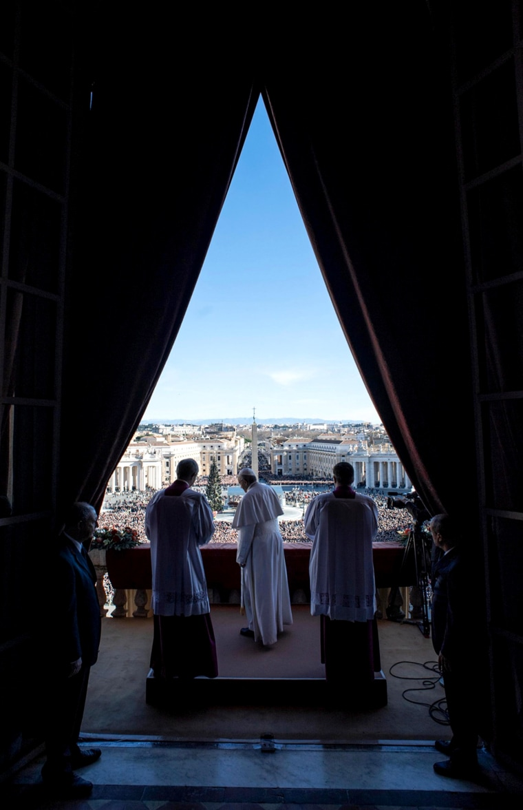 Image: Pope Francis delivers the traditional Christmas Day blessing from the balcony of St. Peter's Basilica at the Vatican on Dec. 25.
