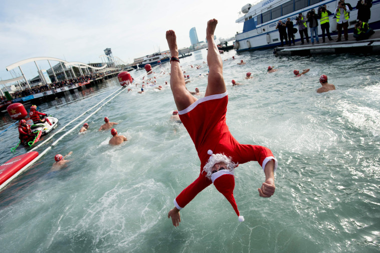 Image: A participant dressed as Santa Claus leaps into the water during the 109th Copa Nadal, or Christmas Cup, swimming competition at Port Vell in Barcelona on Dec. 25.