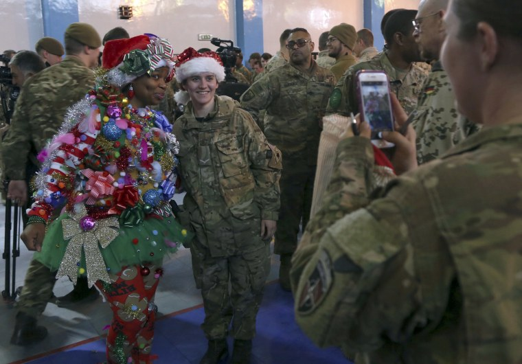 Image: U.S. and NATO forces attend a Christmas Day ceremony in Kabul, Afghanistan, on Dec. 25.