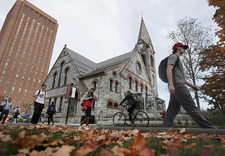 Image: Students pass the Old Chapel at the University of Massachusetts campus in Amherst on Oct. 21, 2016.
