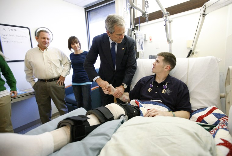 Image: President George W. Bush shakes hands with U.S. Army Staff Sgt. Kyle Stipp after presenting him with two Purple Heart medals at Walter Reed Army Medical Center on Dec. 22, 2008.