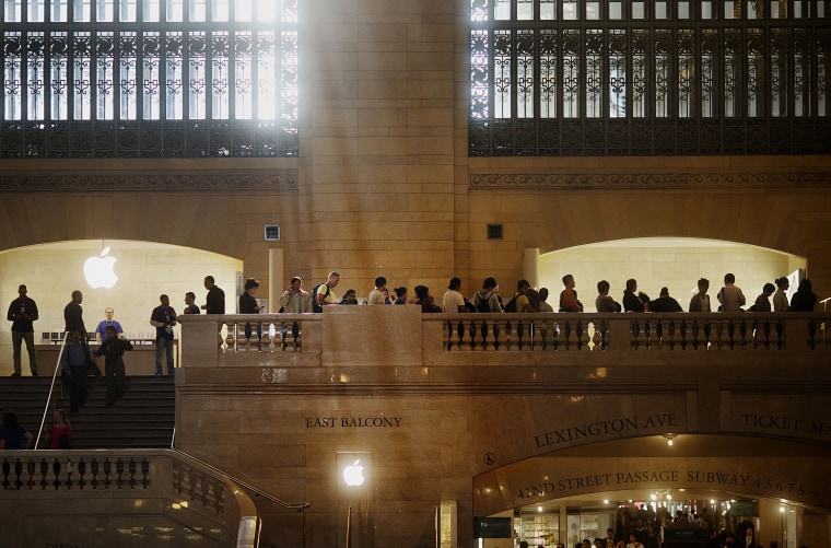 Image: Customers wait in line outside of the Apple store in Grand Central Terminal in New York on Sept. 21, 2012.