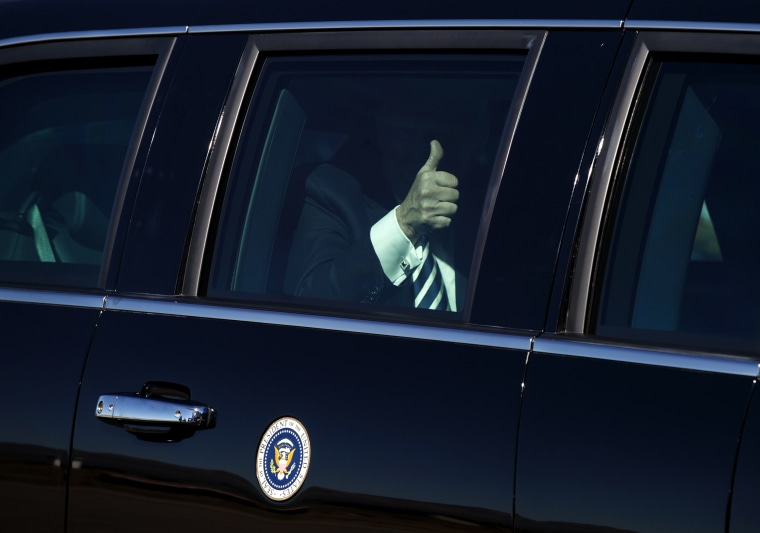 Image: President Donald Trump gives the thumbs-up before boarding Air Force One in Nevada on Oct. 20, 2018.