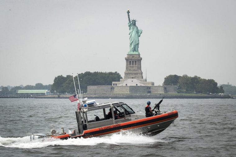 Image: A U.S. Coast Guard boat passes Liberty Island in New York Harbor on Aug. 27, 2018.