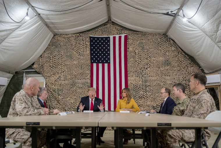 Image: President Donald Trump and Melania Trump meet with National Security Adviser John Bolton, U.S. Ambassador to Iraq Doug Silliman, and military leadership at Al Asad Air Base.