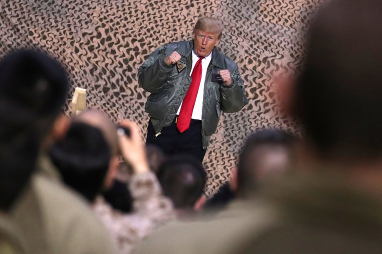 Image: President Donald Trump greets U.S. troops during an unannounced visit to Al Asad Air Base in Iraq.