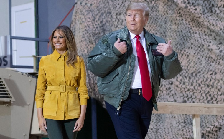 Image: President Donald Trump and First Lady Melania Trump arrive to speak to troops at Al Asad Air Base.