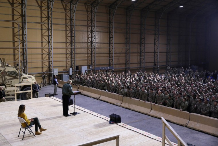 Image: President Donald Trump delivers remarks to U.S. troops inside the hanger at Al Asad Air Base in Iraq.