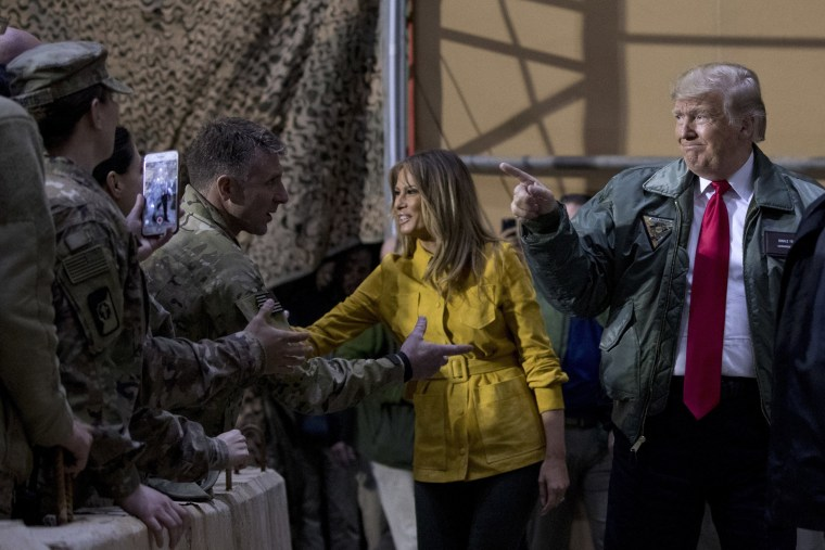 Image: President Donald Trump and first lady Melania Trump greet troops at a hanger rally at Al Asad Air Base in Iraq.