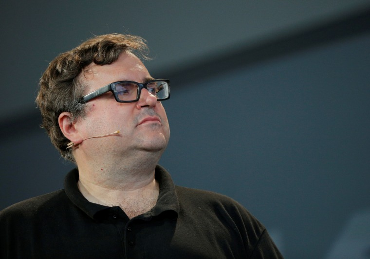 "Reid Hoffman, co-founder of LinkedIn, listens after presenting the inaugural Disobedience Award during ""Defiance!"" at Massachusetts Institute of Technology in Cambridge"