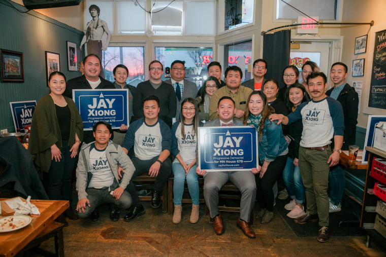 Image: Jay Xiong, center rear, newly elected to Minnesota's legislature, at a campaign event.