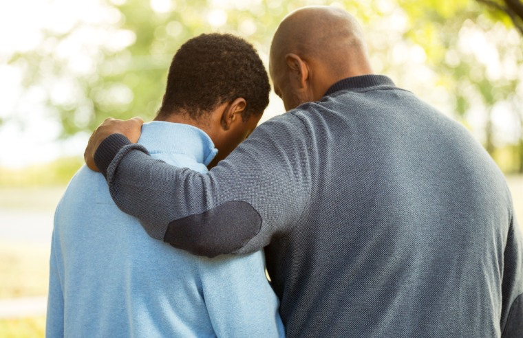 Image: Father and son embrace