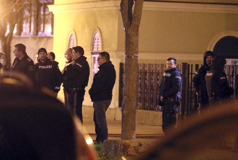 Image: Police stand outside a church after an attack in Vienna, Austria, on Dec. 27, 2018.