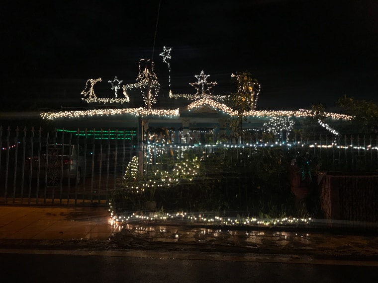 The Christmas lights of a house in Cupey, Puerto Rico shine at night on December 27, 2018.