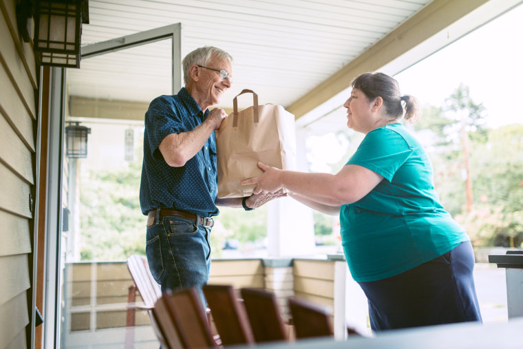 Delivering Groceries To Senior Man