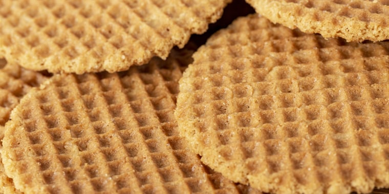 Waffles scattered on a wooden table. Macro. Copy space.