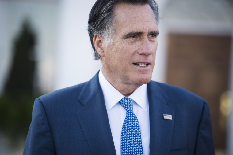 Image: Mitt Romney talks to the media after meeting with President-elect Donald Trump