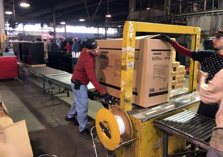 Image: Employees seen working inside the Metal Box International toolbox factory in Franklin Park