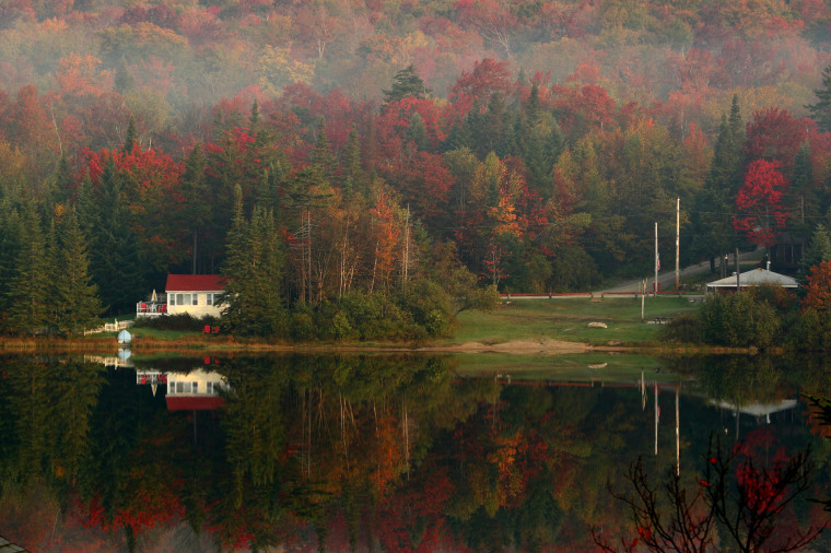 Image: Leaves begin turning color on Big Pond near Woodford, Vermont, in 2007.
