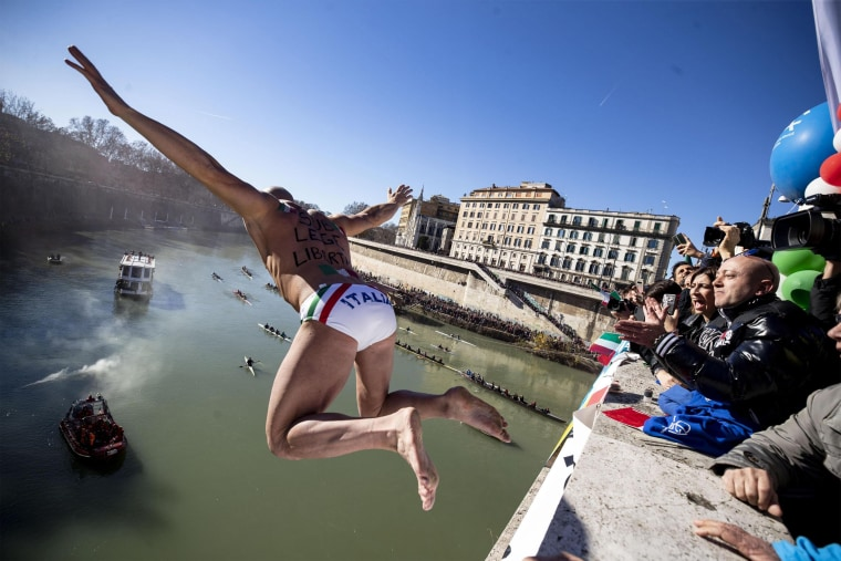 Image: Simone Carabella jumps from the Cavour Bridge into the Tiber River in Rome, Italy. The bridge is 49 feet high.
