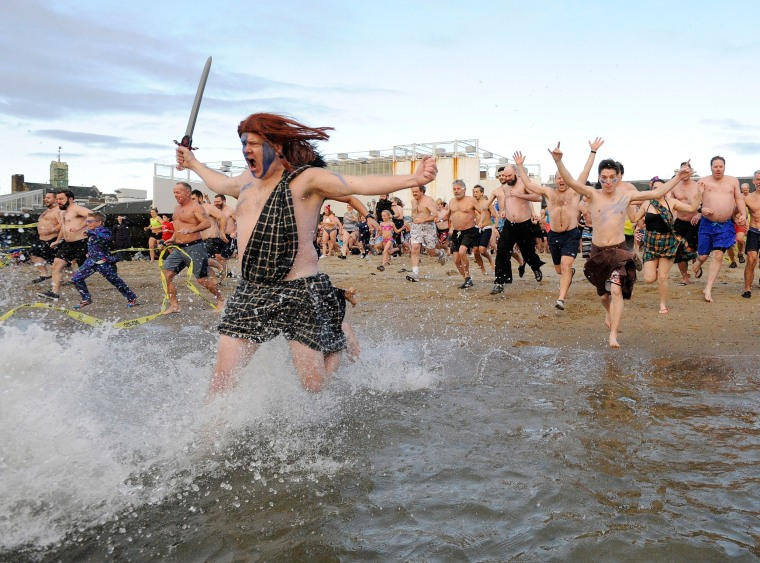 "Image: ""Polar Bear\"" swimmers take part in the L Street Brownies New Year's Day Plunge in South Boston, Massachusetts."