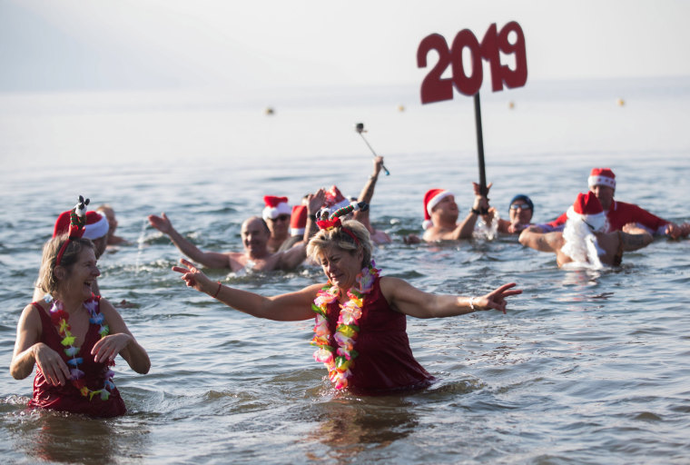 Image: Swimmers dip into the waters of Lago Maggiore in Tenero, Switzerland.