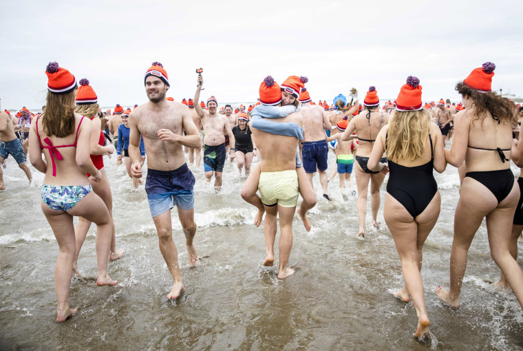 Image: Revelers hug at the plunge in the North Sea in Scheveningen, The Netherlands.