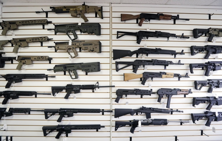Image: Semi-automatic rifles fill a wall at a gun shop in Lynnwood, Washington, on Oct. 2, 2018.