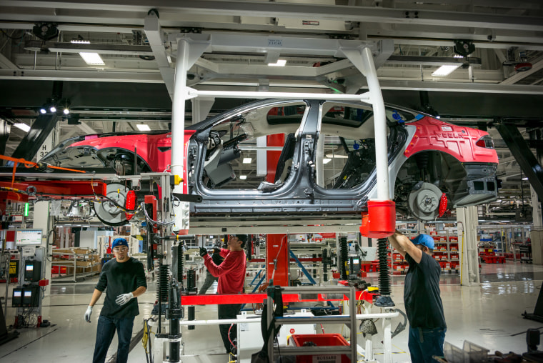 Image: Workers assemble cars on the line at a Tesla factory in Fremont, California, on Feb. 4, 2015.
