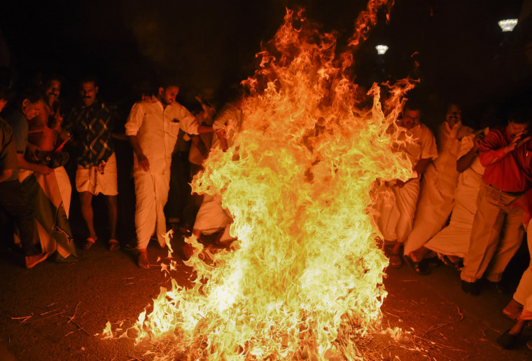 Image: Activists burn an effigy of Chief Minister Pinarayi Vijayan after reports that two women entered the Sabarimala Temple in Karala, India, on Jan. 2, 2019.