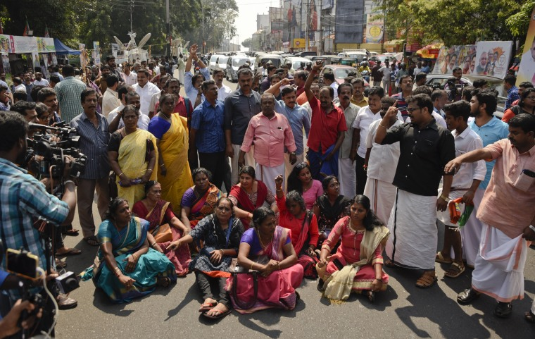 Image: Demonstrators block traffic while protesting reports that two women entered the Sabarimala Temple in Kerala, India, on Jan. 2, 2019.