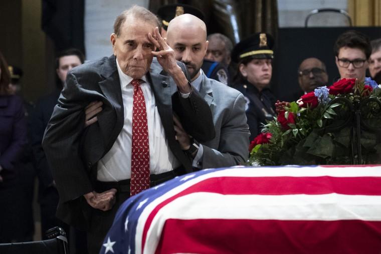 Image: Former Senator Bob Dole salutes the casket of former President George H.W. Bush at the Capitol in Washington on Dec. 4, 2018.