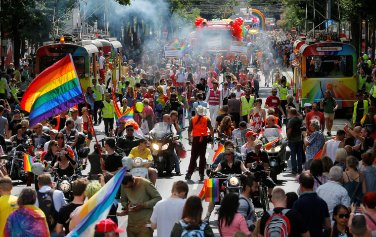 Image: Revelers march in the pride parade in Vienna, Austria, on June 18, 2016.