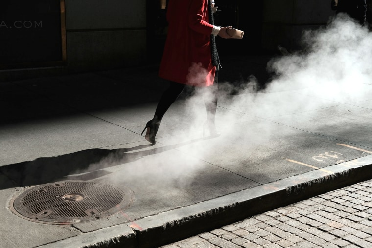 Image:  A woman walks on Wall Street in New York on March 21, 2016.