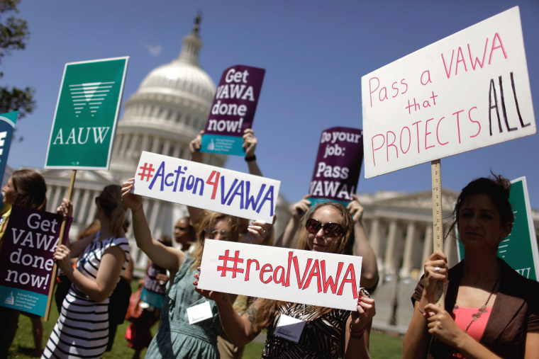 Image: Demonstrators hold a rally in support of the Violence Against Women Act on Capitol Hill on June 26, 2012.
