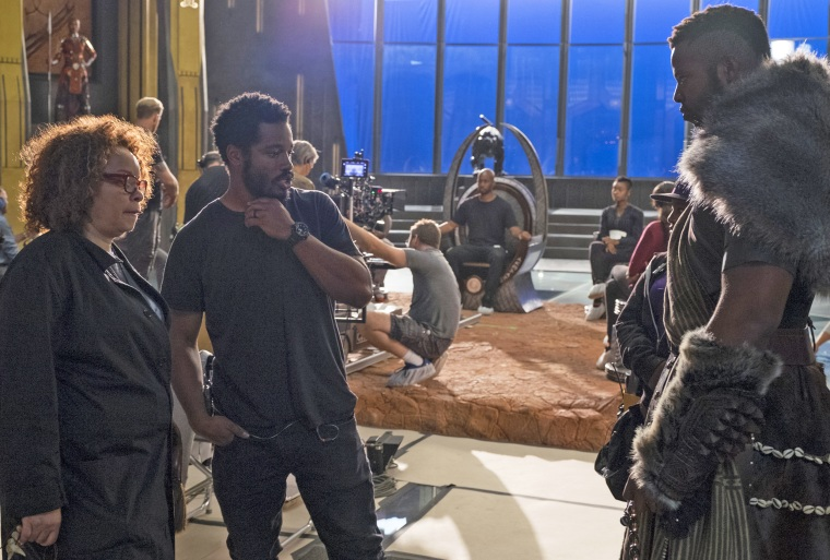 "Costume Designer Ruth Carter and Director Ryan Coogler on the set of Marvel Studios' ""Black Panther"" with Winston Duke (M'Baku)."