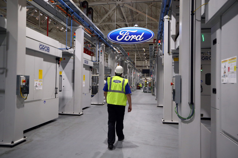 Image: An employee walks near a production line at a Ford factory in England on Jan. 13, 2015.